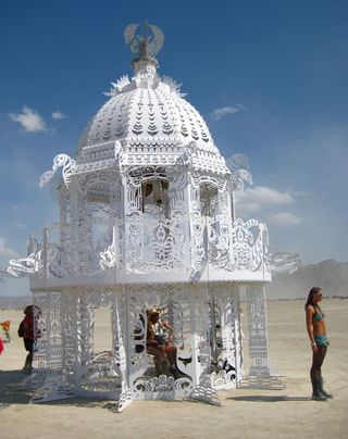Burning man white sculpture