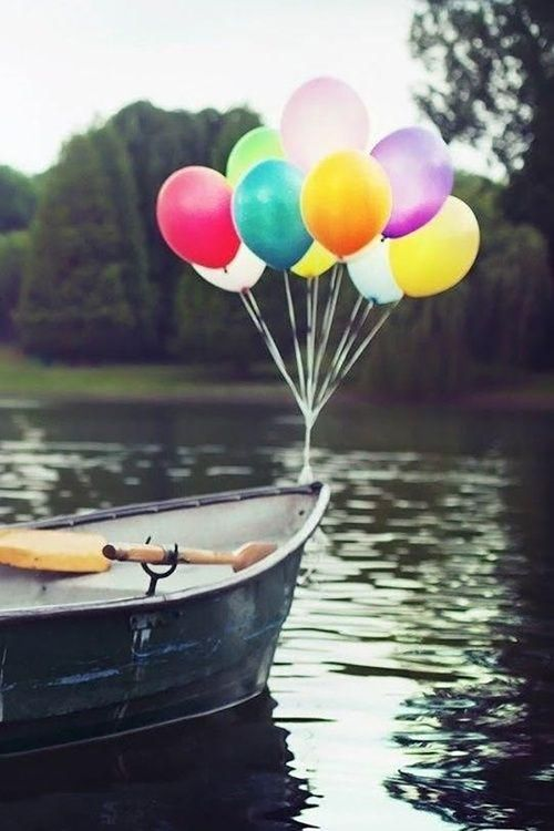 Rowboat with balloons bohocircus